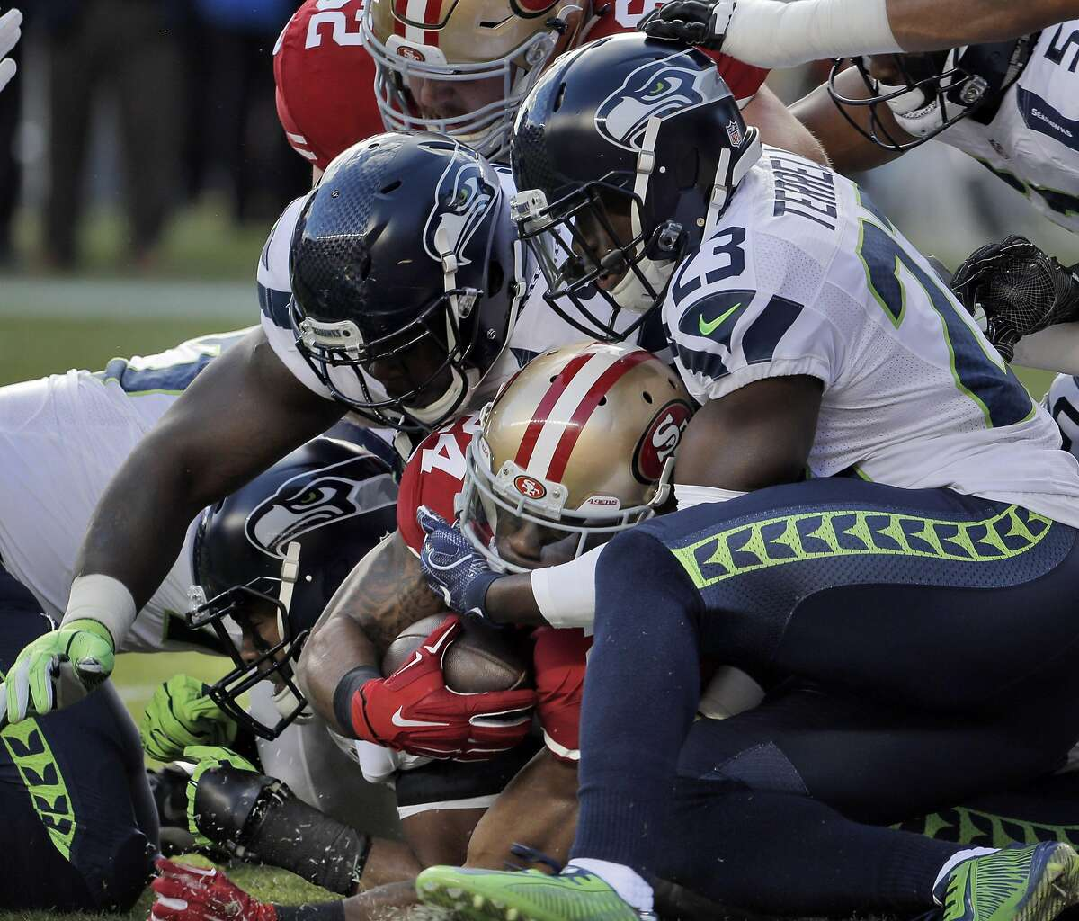 Shaun Draughn (24) punches through for his first touchdown in the first half as the San Francisco 49ers played the Seattle Seahawks at Levi's Stadium in Santa Clara on Sunday, January 1, 2017.
