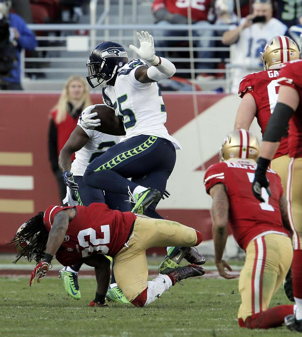 DuJuan Harris (32) tackles Frank Clark (55) after Clark recovered a ball Harris fumbled in the first half as the San Francisco 49ers played the Seattle Seahawks at Levi's Stadium in Santa Clara on Sunday, January 1, 2017.