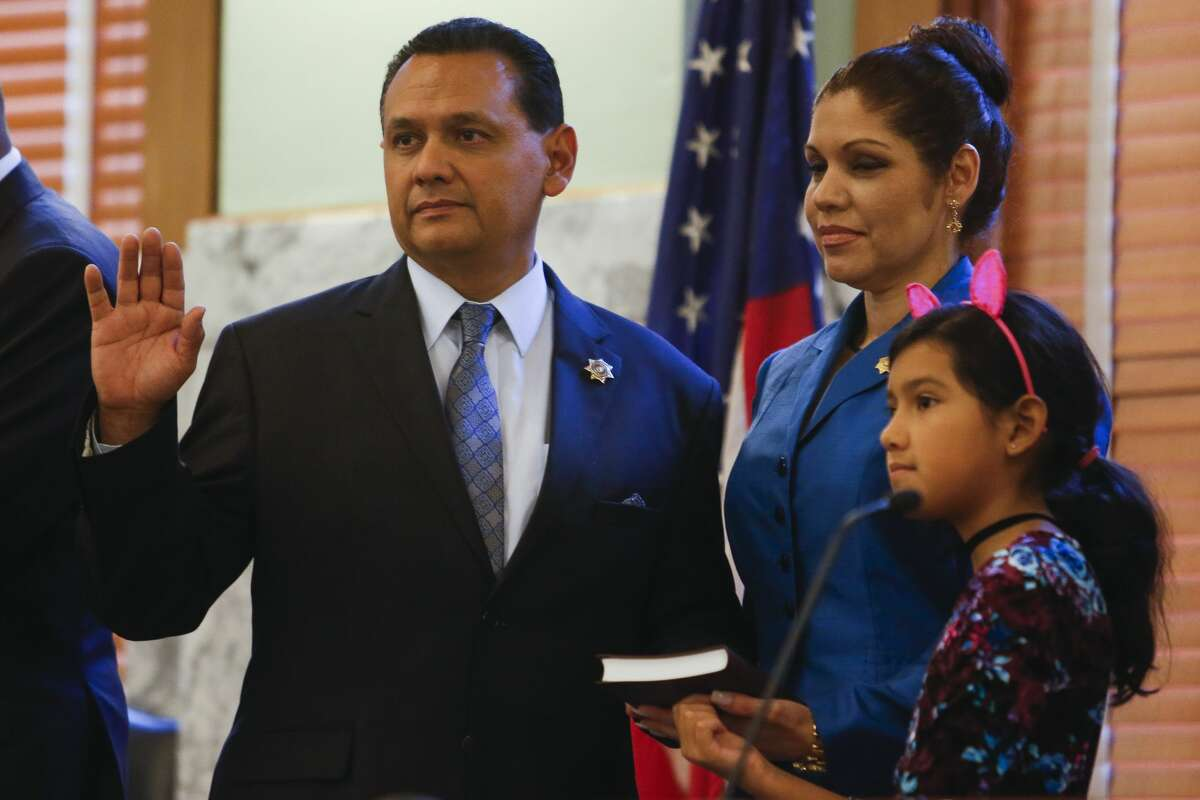 Harris County Sheriff Ed Gonzalez, left, is sworn in next to his families at the historic 1910 Harris County Courthouse Sunday, Jan. 1, 2017 in Houston. ( Michael Ciaglo / Houston Chronicle )