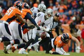 DENVER, CO - JANUARY 1:  Outside linebacker Shane Ray #56 of the Denver Broncos sacks quarterback Connor Cook #8 of the Oakland Raiders, who fumbles the ball in the third quarter of the game at Sports Authority Field at Mile High on January 1, 2017 in Denver, Colorado. (Photo by Dustin Bradford/Getty Images)
