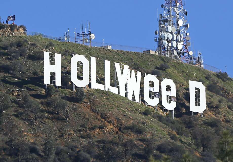 "The Hollywood sign is seen vandalized Sunday, Jan. 1, 2017. Los Angeles residents awoke New Year's Day to find a prankster had altered the famed Hollywood sign to read ""HOLLYWeeD."" Police have also notified the city's Department of General Services, whose officers patrol Griffith Park and the area of the rugged Hollywood Hills near the sign. California voters in November approved Proposition 64, which legalized the recreational use of marijuana, beginning in 2018. (AP Photo/Damian Dovarganes) Photo: Damian Dovarganes, Associated Press"