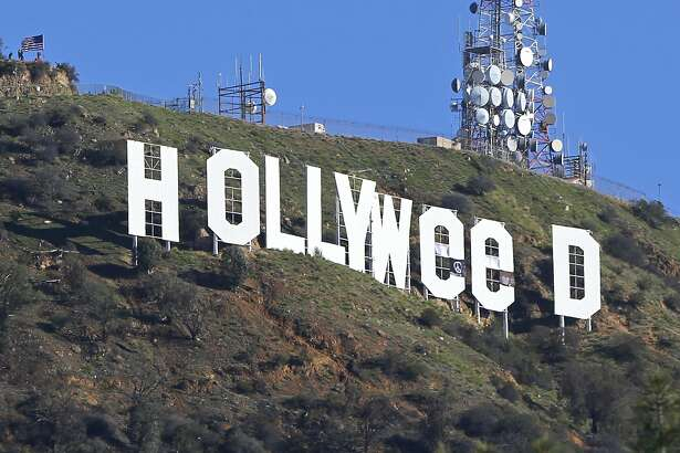 "The Hollywood sign is seen vandalized Sunday, Jan. 1, 2017. Los Angeles residents awoke New Year's Day to find a prankster had altered the famed Hollywood sign to read ""HOLLYWeeD."" Police have also notified the city's Department of General Services, whose officers patrol Griffith Park and the area of the rugged Hollywood Hills near the sign. California voters in November approved Proposition 64, which legalized the recreational use of marijuana, beginning in 2018. (AP Photo/Damian Dovarganes)"