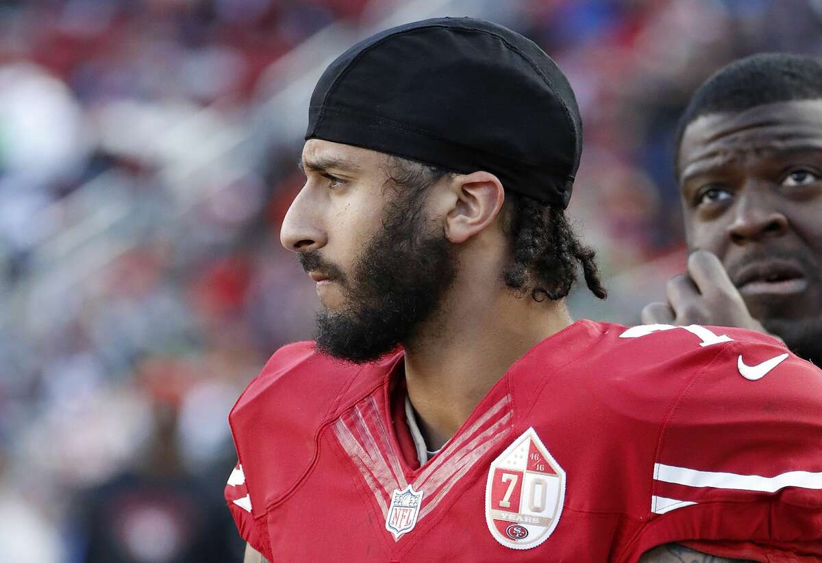 San Francisco 49ers quarterback Colin Kaepernick stands on the sideline during the second half of an NFL football game against the Seattle Seahawks in Santa Clara, Calif., Sunday, Jan. 1, 2017. (AP Photo/Tony Avelar)
