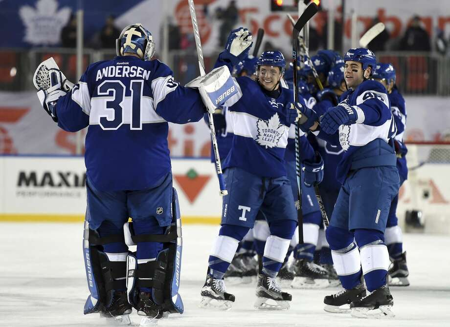 Toronto Maple Leafs goalie Frederik Andersen (31) celebrates with teammates Roman Polak (46) and Tyler Bozak (42) following overtime NHL Centennial Classic hockey action against the Detroit Red Wings, in Toronto, Sunday, Jan. 1, 2017. (Frank Gunn/The Canadian Press via AP) Photo: Frank Gunn/Associated Press