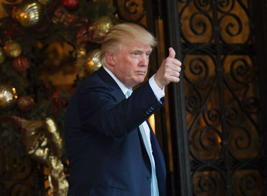 US President-elect Donald Trump speaks to reporters between meetings December 28, 2016 at Mar-a-Lago. Photo: DON EMMERT, AFP/Getty Images