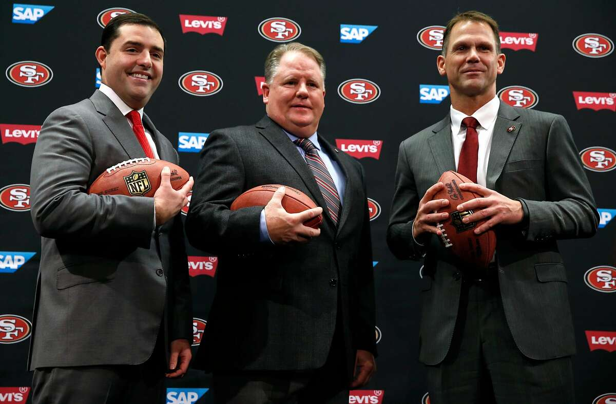 Chip Kelly (center) is flanked by team CEO Jed York and general manager Trent Baalke after Kelly is introduced as the new head coach of the San Francisco 49ers at Levi's Stadium in Santa Clara, Calif. on Wednesday, Jan. 20, 2016.