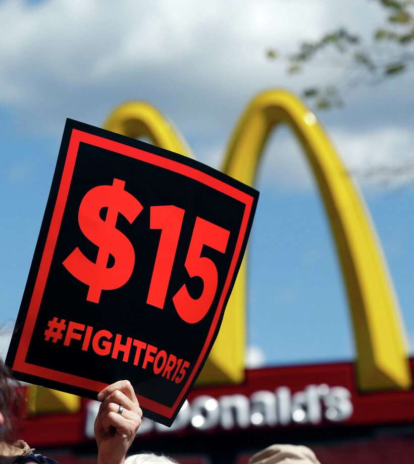 Supporters of fast food workers in New York rallied in July in Albany. New York state is taking a regional approach to a minimum wage increase. Photo: Mike Groll, STF / Copyright 2016 The Associated Press. All rights reserved.