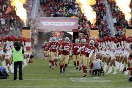 The 49ers enter the field before game during introduction before they played the Seattle Seahawks at Levi's Stadium in Santa Clara, Calif., on Sunday, January 1, 2017.