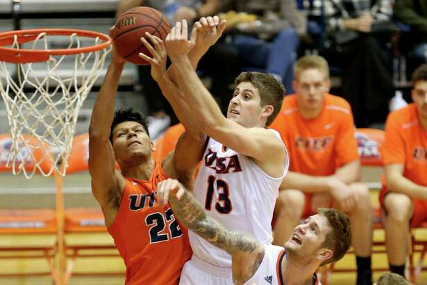 UTEP's Paul Thomas (from left) and UTSA's Byron Frohnen and Nick Allen battle for rebound during first half action on Jan. 1, 2017 at the Convocation Center.