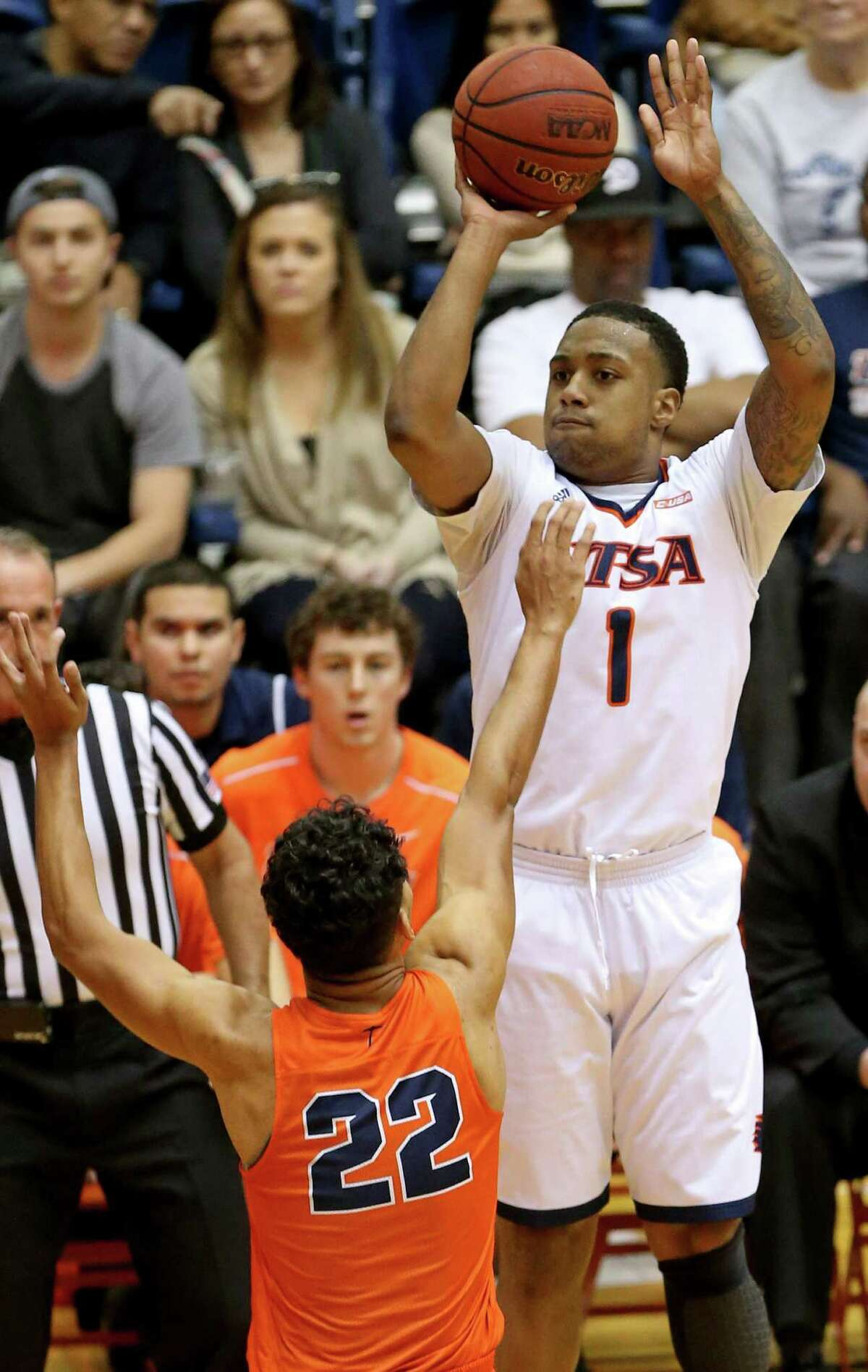 UTSA's Jeff Beverly shoots over UTEP's Paul Thomas during first half action on Jan. 1, 2017 at the Convocation Center.