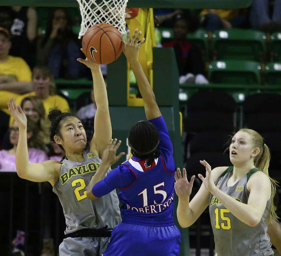 Baylor guard Natalie Chou (24) blocks the shot of Kansas guard Aisia Robertson in the second half of the third-ranked Lady Bears' 90-43 victory Sunday. Photo: Jerry Larson, FRE / FRE91203 AP