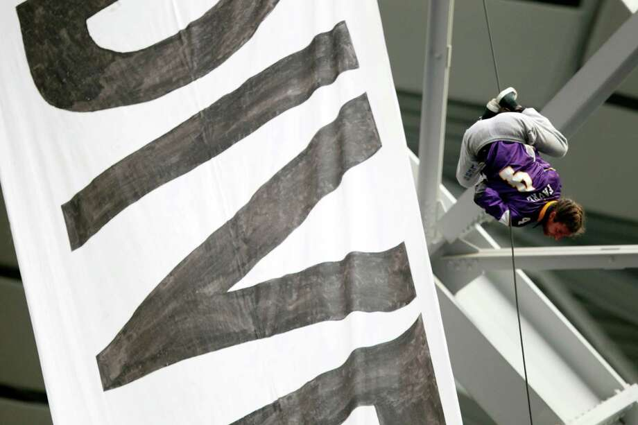 A protestor against the Dakota Access Pipeline repels from the catwalk in U.S. Bank Stadium during the first half of an NFL football game between the Minnesota Vikings and the Chicago Bears, Sunday, Jan. 1, 2017, in Minneapolis. (AP Photo/Andy Clayton-King) Photo: Andy Clayton-King, FRE / FR51399 AP