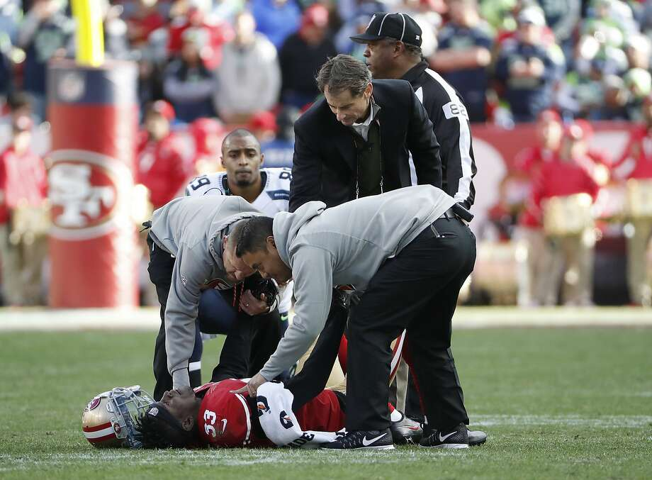 Cornerback Rashard Robinson is tended to by 49ers trainers after injuring his ankle in the first half of San Francisco's 25-23 loss to the Seattle Seahawks on Sunday at Levi's Stadium. Photo: Tony Avelar, Associated Press