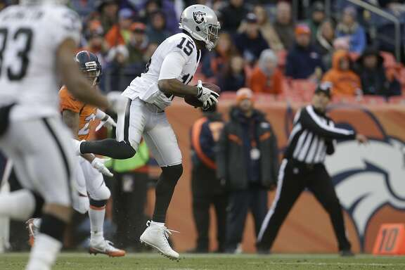 Oakland Raiders wide receiver Michael Crabtree makes a catch in the second half of an NFL football game against the Denver Broncos, Sunday, Jan. 1, 2017, in Denver. (AP Photo/Joe Mahoney)