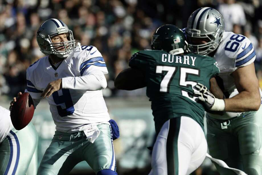 Tony Romo looks to throw in the first half of the Cowboys' loss. He was 3 for 4 for 29 yards and a TD in his first action this season. Photo: Michael Perez / Associated Press / FR168006 AP