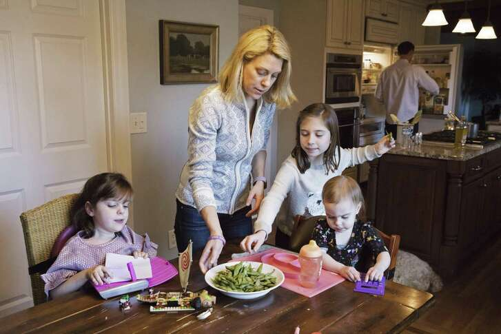Kacey Farrell with her children, Blake (from left), 6; Finley, 8; and Holland, 1, eat lunch at home in Cincinnati. Blake's spinal muscular atrophy symptoms improved after being treated with Spinraza, which Biogen won regulatory approval for last week. By some estimates, it will be among the most expensive drugs in the world.