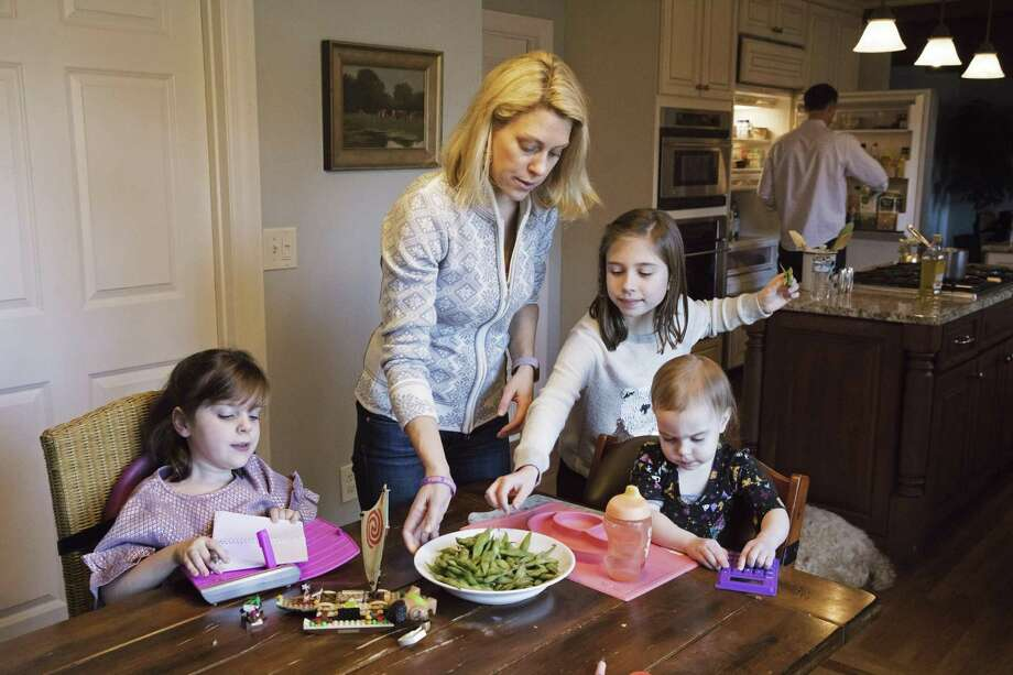 Kacey Farrell with her children, Blake (from left), 6; Finley, 8; and Holland, 1, eat lunch at home in Cincinnati. Blake's spinal muscular atrophy symptoms improved after being treated with Spinraza, which Biogen won regulatory approval for last week. By some estimates, it will be among the most expensive drugs in the world. Photo: Philip Scott Andrews /New York Times / NYTNS