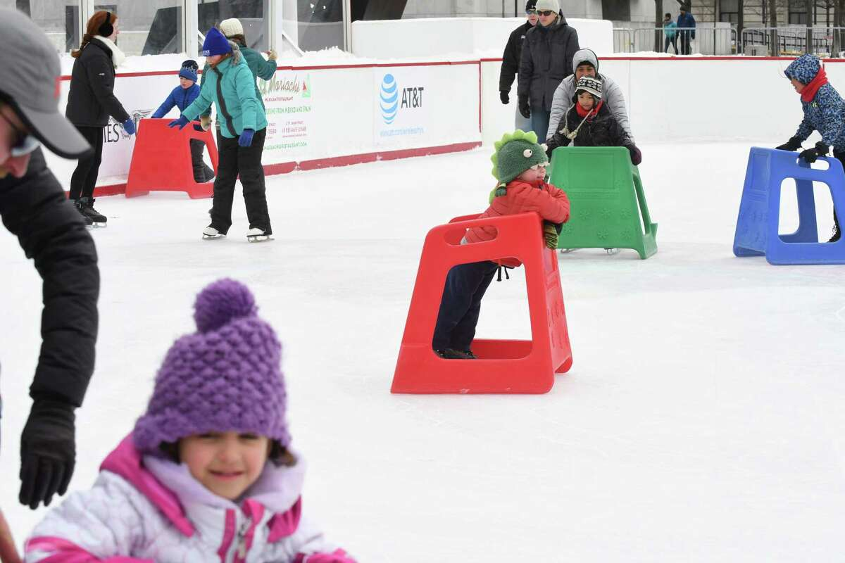 Skaters take to the ice at the Empire State Plaza Rink on Saturday Dec. 31, 2016 in Albany, N.Y. (Michael P. Farrell/Times Union)