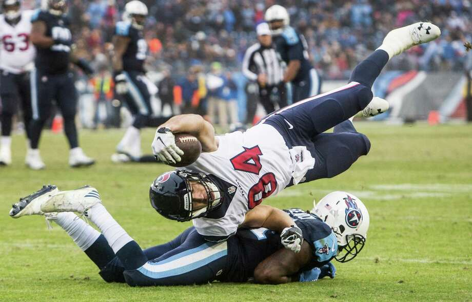 Texans tight end Ryan Griffin (84) is upended by Titans strong safety Da'Norris Searcy short of a first down during the fourth quarter Sunday. Griffin had two catches for 10 yards. Photo: Brett Coomer, Staff / © 2017 Houston Chronicle