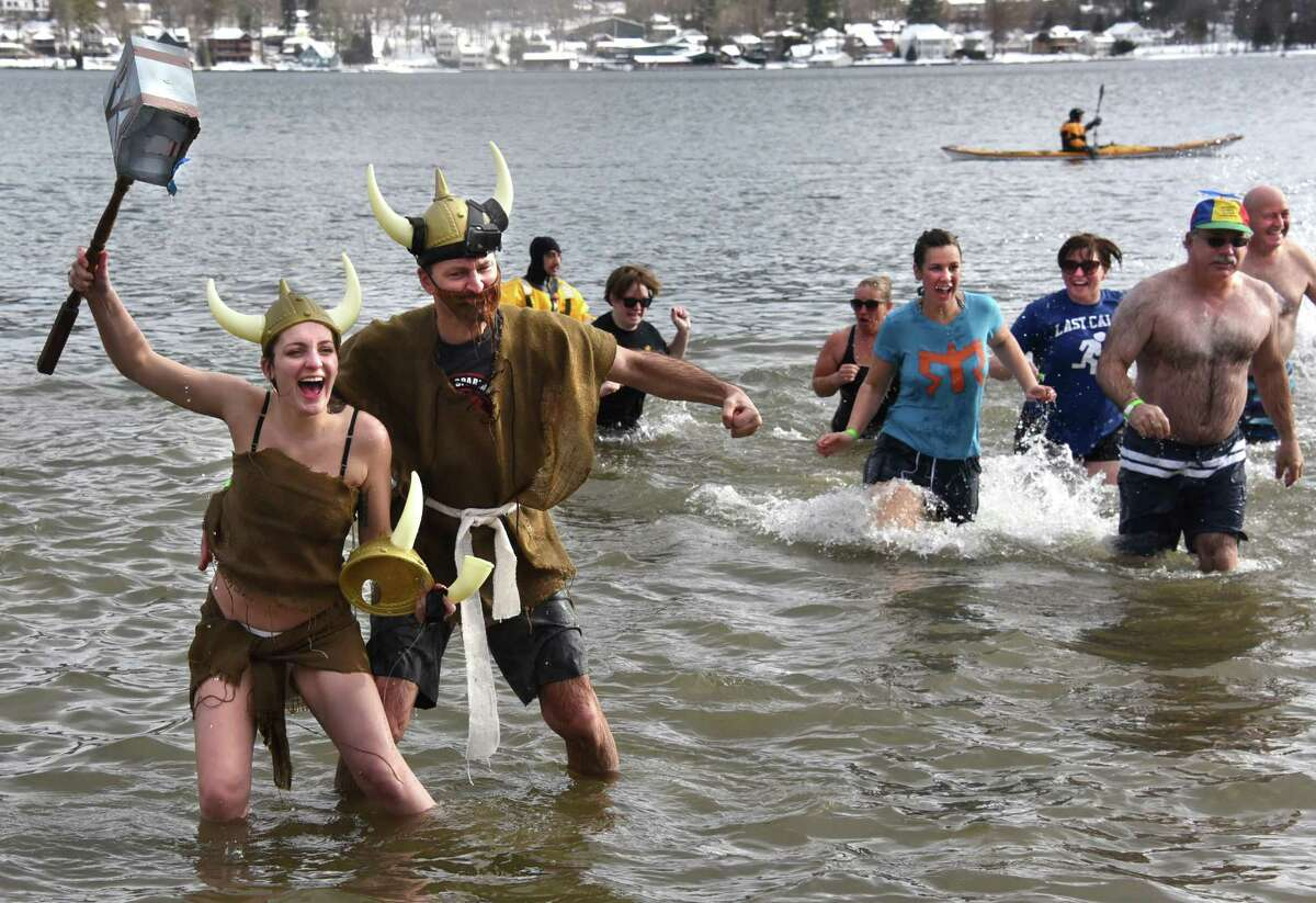 Amanda Sadera of Austin, TX and her father C.J. Sadera of Orange County are dressed as vikings as they run into the cold water on Shepard Park Beach during the annual Polar Plunge on Sunday, Jan. 1, 2017 in Lake George, N.Y. (Lori Van Buren / Times Union)