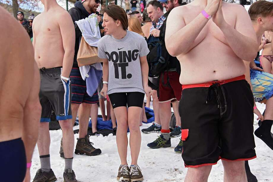 Participants wait to run into the cold water on Shepard Park Beach during the annual Polar Plunge on Sunday, Jan. 1, 2017 in Lake George, N.Y. (Lori Van Buren / Times Union) Photo: Lori Van Buren / 20039281A