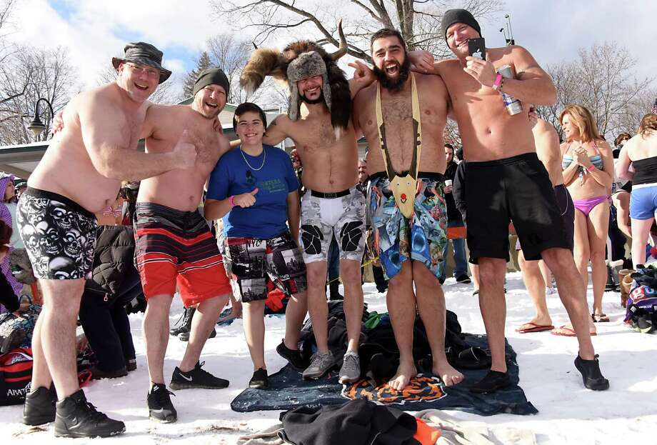 Participants wait to run into the cold water on Shepard Park Beach during the annual Polar Plunge on Sunday, Jan. 1, 2017 in Lake George, N.Y. (Lori Van Buren / Times Union) Photo: Lori Van Buren / 20039281A