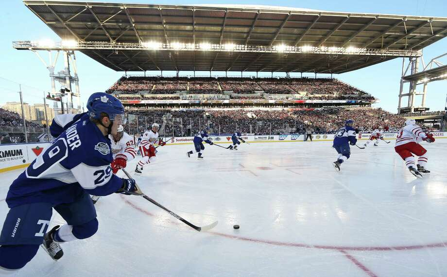 Toronto center William Nylander (29) looks for an open teammate during Sunday's NHL Centennial Classic against Detroit at BMO Field in Toronto. The outdoor game was delayed 30 minutes by sun on the ice, but the Maple Leafs got regulation and overtime goals by rookie Auston Matthews to defeat the Red Wings 5-4. Photo: Claus Andersen, Stringer / 2017 Getty Images