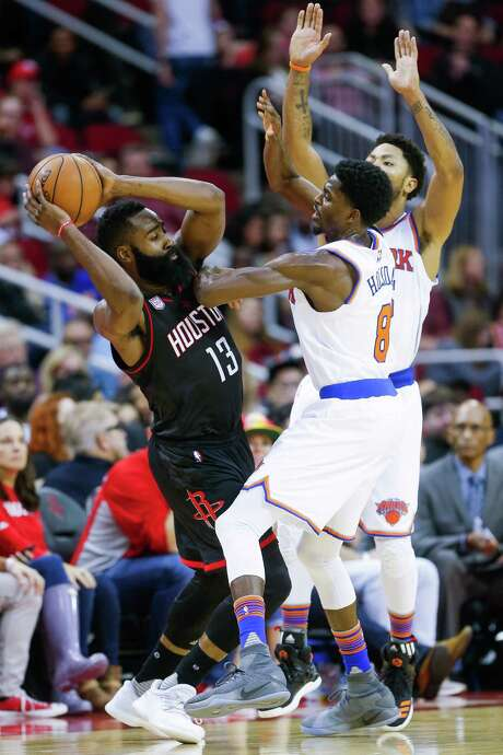 Rockets guard James Harden (13) draws plenty of attention Saturday night as he looks to pass around Knicks guards Justin Holiday, left, and Derrick Rose. The Knicks had reason to be concerned. Harden had 53 points, 17 assists and 16 rebounds in the Rockets' 129-122 victory at Toyota Center. Photo: Michael Ciaglo, Staff / © 2016  Houston Chronicle