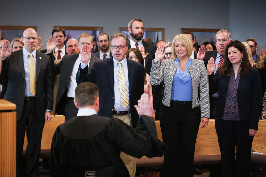 Judge Phil Grant swears in the assistant district attorneys during the oath swearing ceremony on Sunday, Jan. 1, 2017, at the Alan B. Sadler Commissioners Court Building. Photo: Michael Minasi, Staff / © 2017 Houston Chronicle
