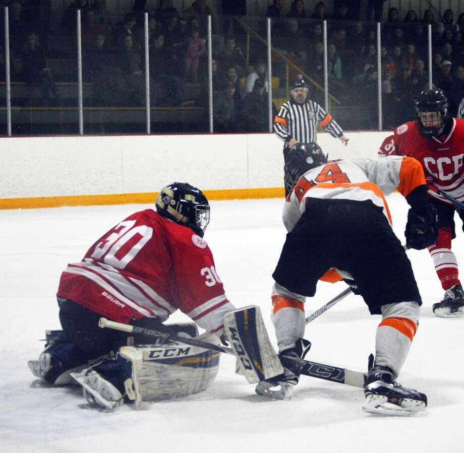 Edwardsville forward Tyler Schaeffer, right, scores in the second period to pass his cousin for the all-time lead in program history.