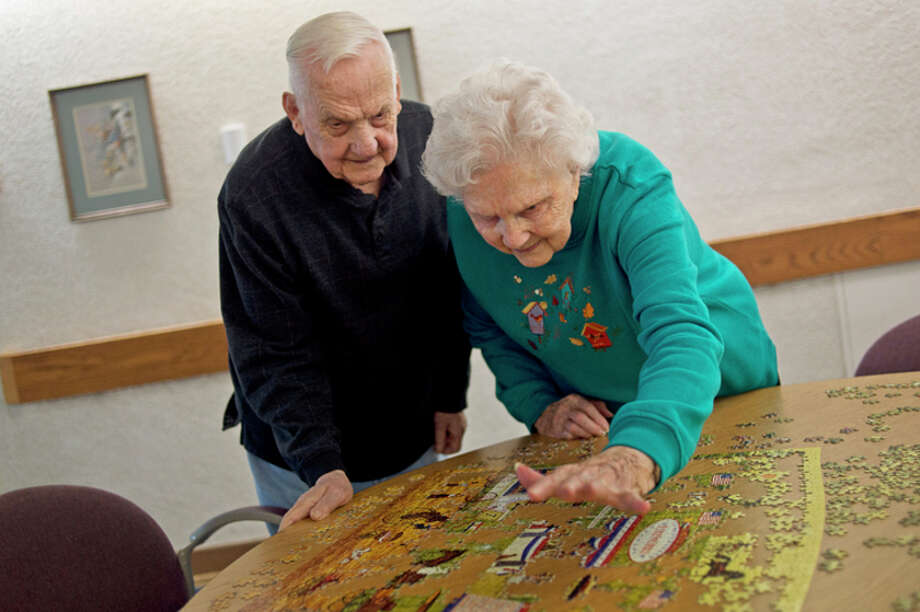 ERIN KIRKLAND | ekirkland@mdn.net Leon, 95, and Fran Sycle, 93, work on a puzzle on Thursday at Riverside Place. The Sycles have been married for 75 years and were married on Jan. 1, 1942. 'Learning to compromise for one thing, and being able to forgive and not fight too much,' Fran said were the keys to a long marriage. The two often work on puzzles during the day.