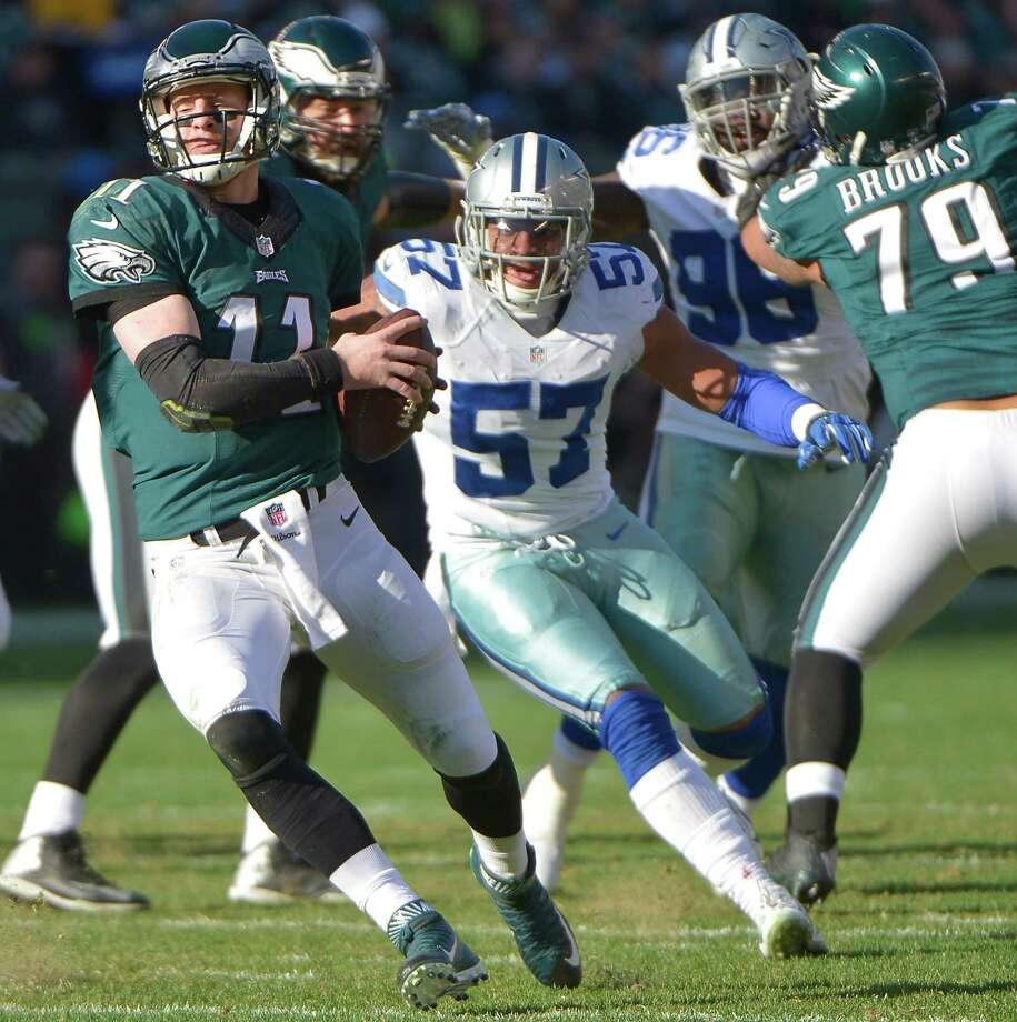 Dallas Cowboys linebacker Damien Wilson (57) puts pressure on Philadelphia Eagles quarterback Carson Wentz (11) during the second quarter at Lincoln Financial Field in Philadelphia on Sunday, Jan. 1, 2017. The Eagles won, 27-13. Photo: Max Faulkner, TNS / Fort Worth Star-Telegram