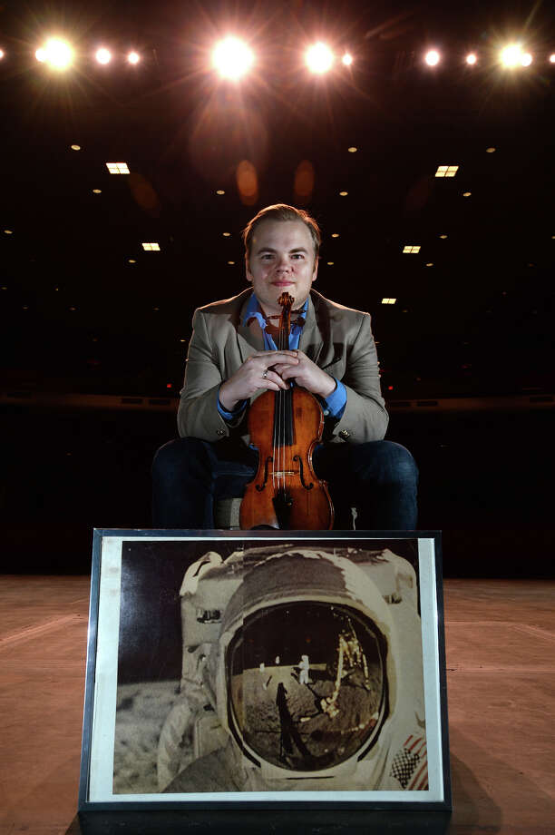 "Violinist Matt Detrick is the Symphony of Southeast Texas' current concertmaster. Detrick is the Artistic and Executive Director of ""Apollo Chamber Players,"" a group of performers that combine Western classical and folk/ethnic music. Detrick said the Apollo name came from his childhood dream to be an astronaut. Photo taken Wednesday, December 21, 2016 Guiseppe Barranco/The Enterprise Photo: Guiseppe Barranco, Photo Editor"