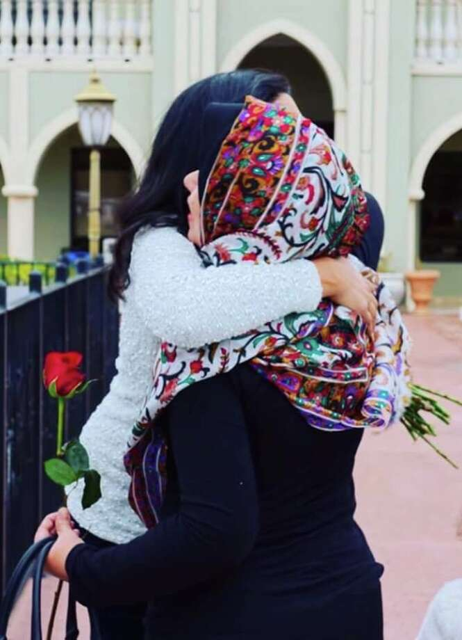 A couple of participants share a hug at a Day of Solidarity event held at the The Maryam Islamic Center in Sugar Land on Dec. 2, 2016. Photo: Submitted Photo
