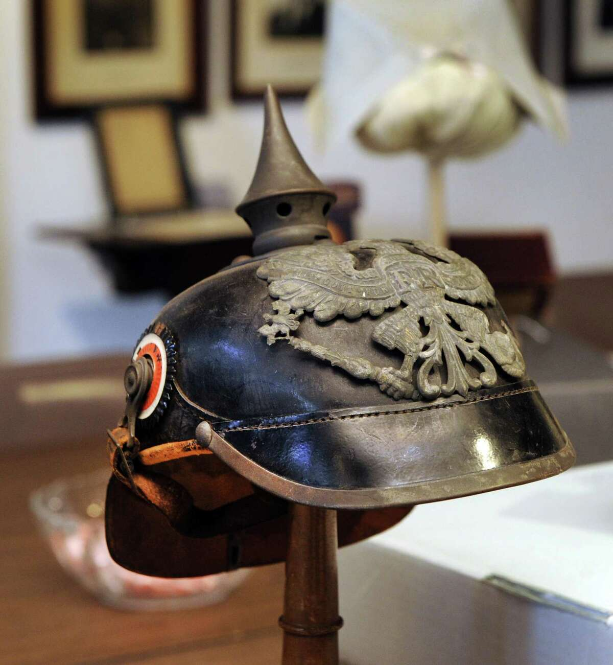 The New Milford Historical Society and Museum is preparing an exhibit of World War I memoribilia and artifacts, including this German helmet. Photo Friday, Dec. 30, 2016.