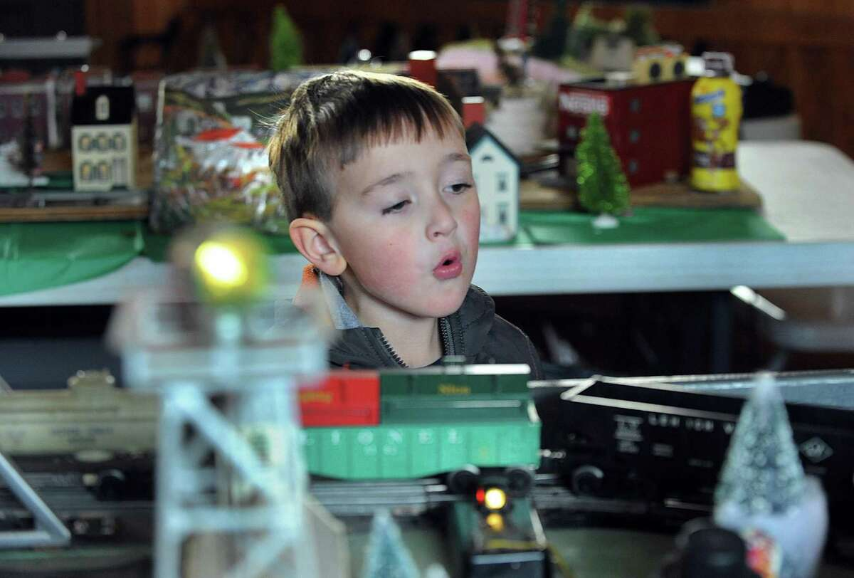 Andrew Stoffa, 3 1/2, of New Milford, makes the sound of a train whistle as a model train passes on the track at the 29th annual train display Friday, Dec. 30, 2016, at the old New Milford train station on Railroad Street.