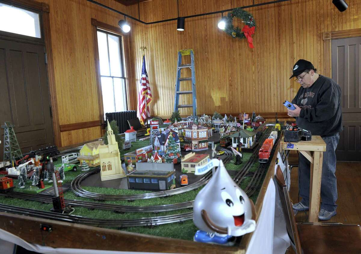 Adam Weaver, of New Milford, a volunteer who helps keep the train exhibit in good working order, tends to the display at the old New Milford train station on Railroad Street Friday, Dec. 30, 2016.