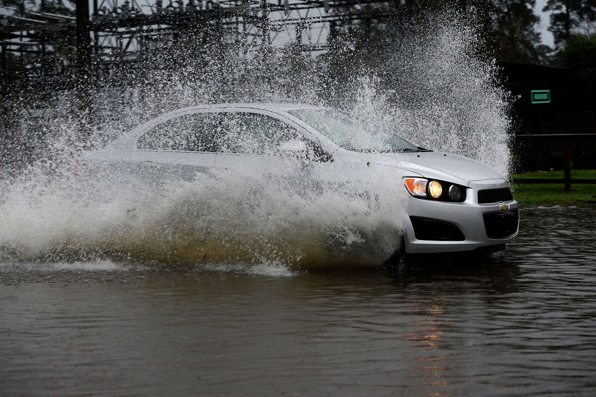 Motorists drive through a flooded section of Delaware Street by Wuthering Heights Park after heavy storms in 2017. Photo taken Monday 1/2/17 Ryan Pelham/The Enterprise
