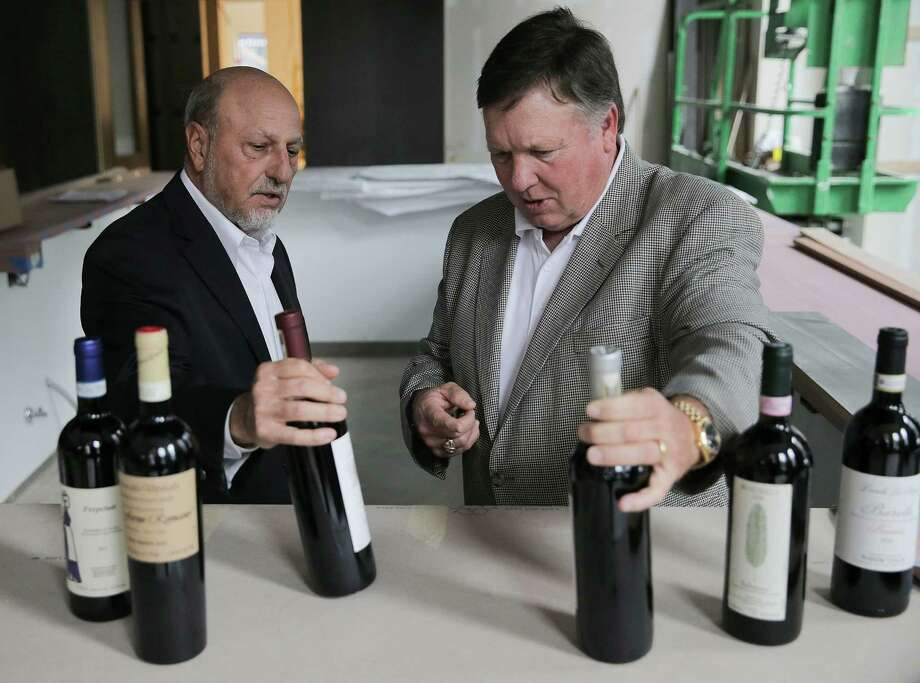 Rick Jamail, left, and Bill Floyd go over wine for their new high-end Italian restaurant downtown. Photo: Elizabeth Conley, Staff / © 2016 Houston Chronicle