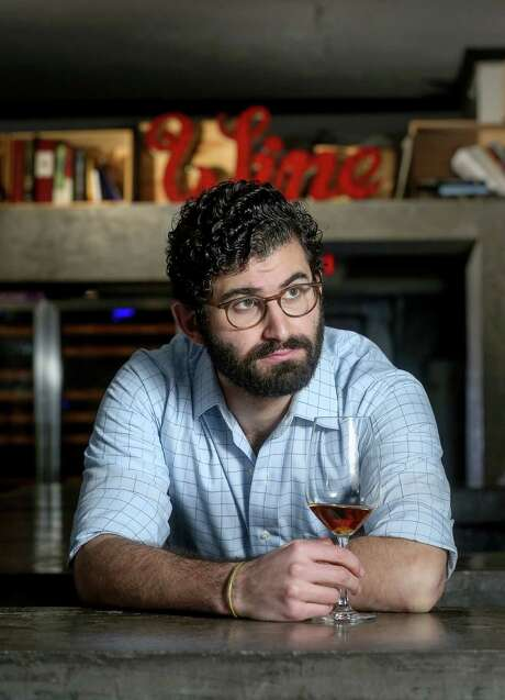 Chris Poldoian recommends a glass of El Maestro Sierra, a 15 Year Oloroso Sherry. Photo: Jon Shapley, Staff / © 2015  Houston Chronicle