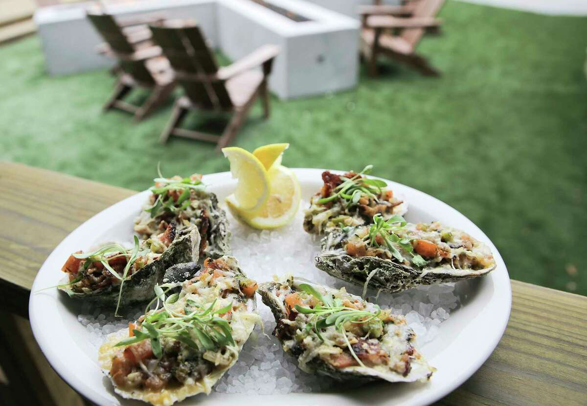 Barbecue oysters with garlic butter, bacon, chimmirchurri and citrus pico at the new Beaver's Westheimer.
