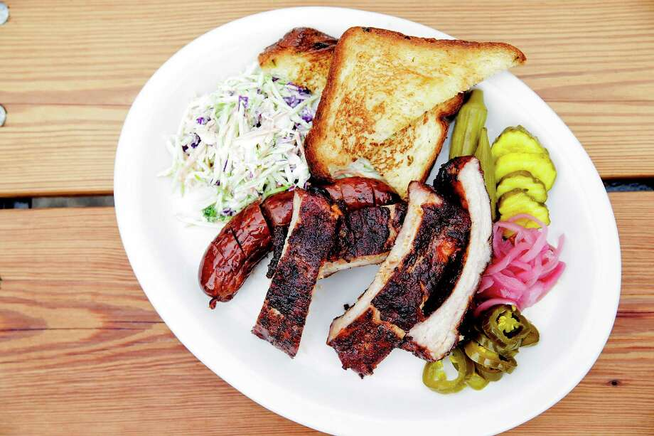 Beaver's on Westheimer serves a barbecue sampler platter.>> Click to see barbecue joints in Texas that are worth the drive. >> Photo: Elizabeth Conley, Staff / © 2016 Houston Chronicle