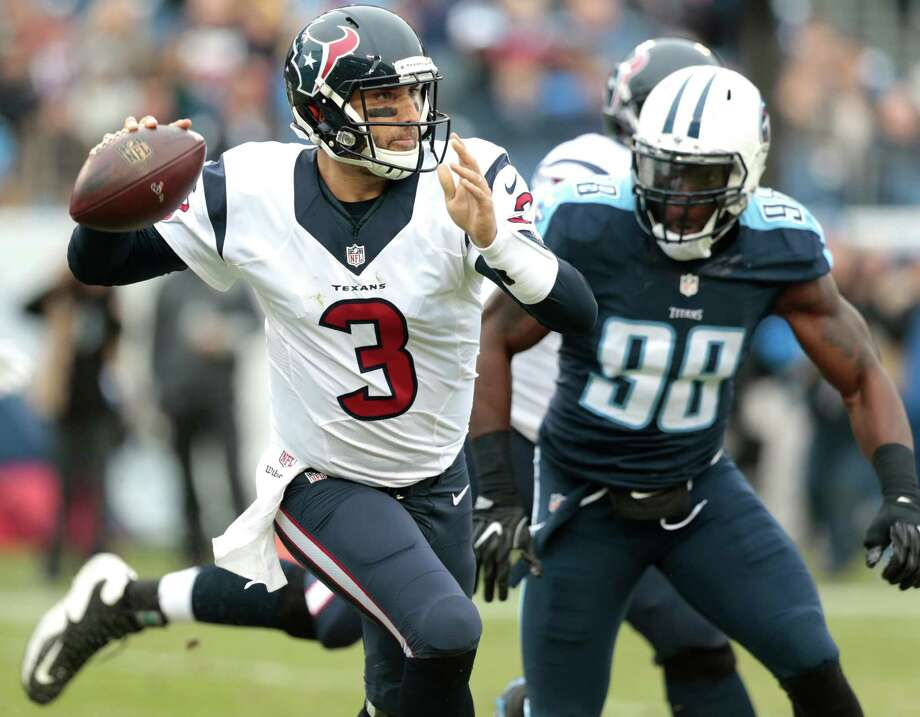 Houston Texans quarterback Tom Savage (3) is pressured by Tennessee Titans outside linebacker Brian Orakpo (98) as he rolls out to pass during the first quarter of an NFL football game at Nissan Stadium on Sunday, Jan. 1, 2017, in Nashville. Photo: Brett Coomer, Houston Chronicle / © 2017 Houston Chronicle