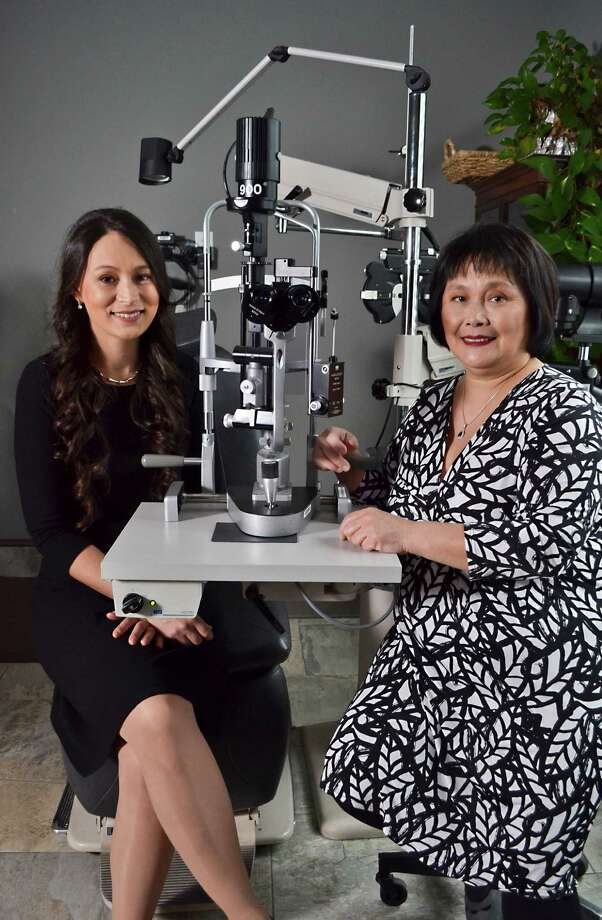 Dr. Nicole Lemanski, MD (left) and Dr. Mabel Cheng, MD (right), in an examination room at their ophthalmology practice, Mabel MP Cheng, MD &Dr. Nicole Lemanski, MD, on Tuesday, November 22, 2016 in Latham, N.Y. (Colleen Ingerto / Times Union) Photo: Colleen Ingerto / Times Union