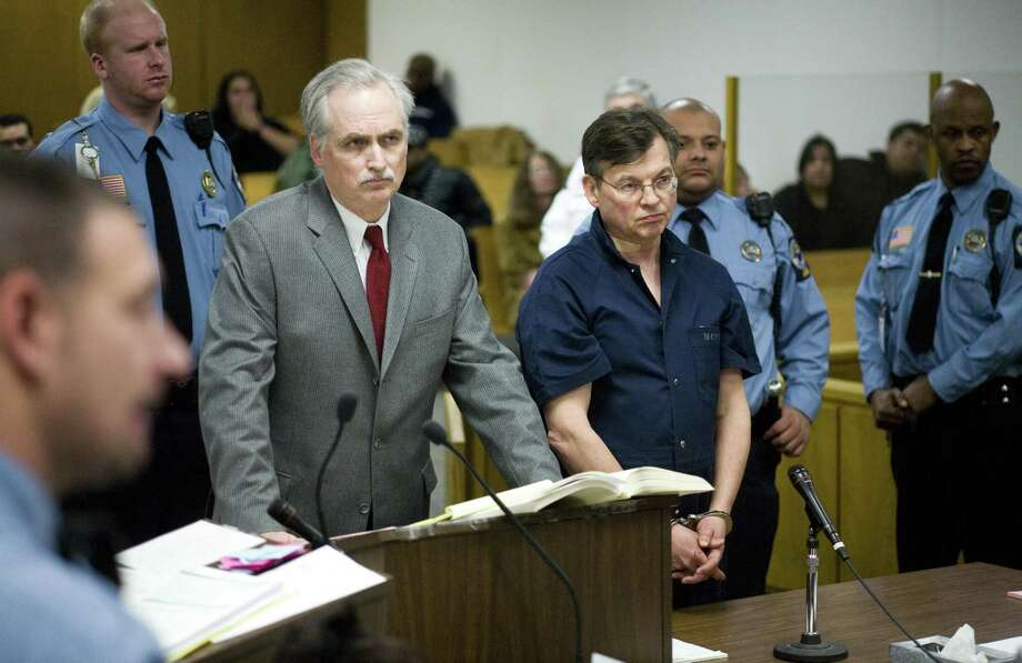 John Michael Farren of New Canaan, center right, is arraigned in state Superior Court in Norwalk Thursday after he was charged with attempted murder and strangulation following a report of a domestic dispute shortly after 10 p.m. At center left is his attorney, Eugene Riccio. Special Dru Nadler Photo: Kerry Sherck / ST / 00007390A