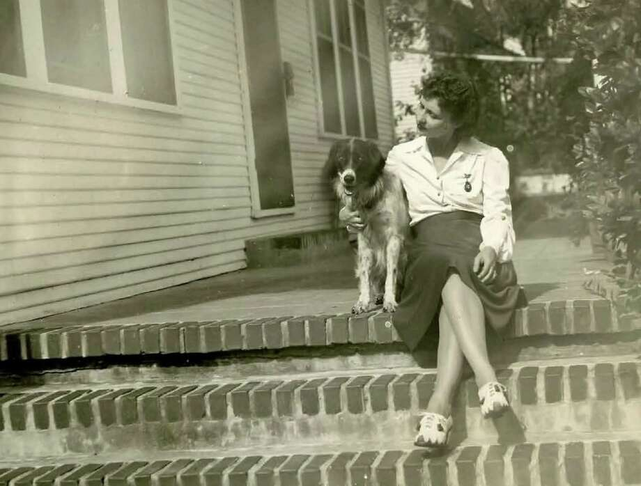 Bessie Goethel with her dog Fritzie whom she loaned to the U.S. Military as a military dog in the early 1940's. Photo: Courtesy UTSA Library Special Collections