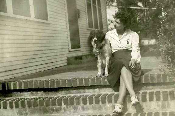Bessie Goethel with her dog Fritzie whom she loaned to the U.S. Military as a military dog in the early 1940's.