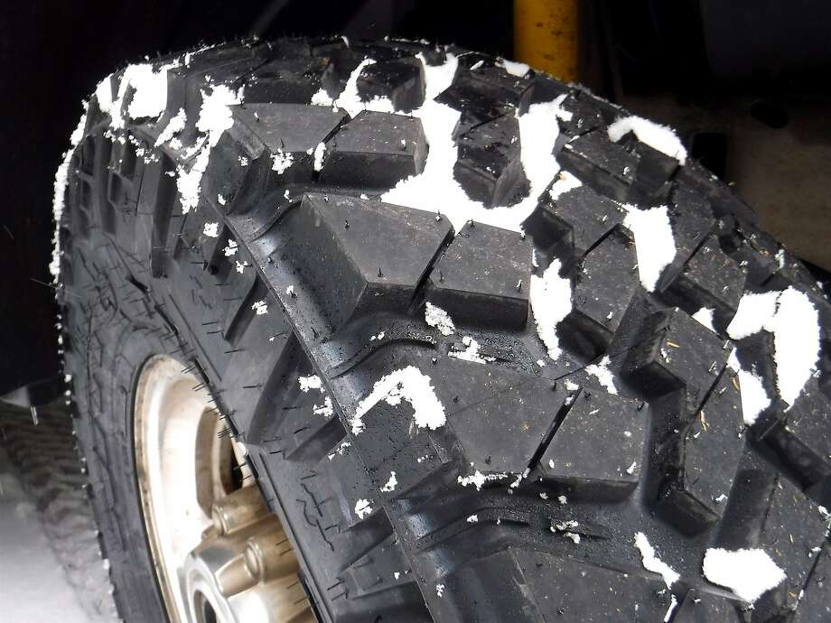 One of the tires on Stienstra's super-duty 4-wheel-drive pickup truck, which is ready for the snow. Photo: Tom Stienstra, Tom Stienstra / The Chronicle