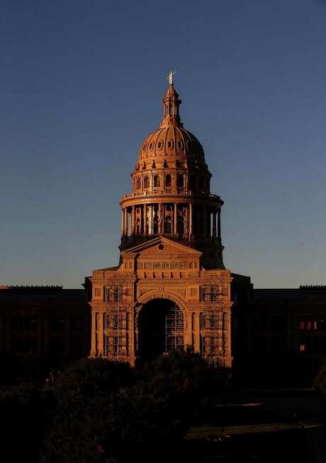 The sun sets over the Texas Capitol Friday, Oct. 21, 2016, in Austin.  ( Jon Shapley / Houston Chronicle ) Photo: Jon Shapley, Staff / Houston Chronicle / © 2015  Houston Chronicle