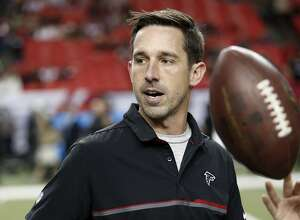 FILE - In this Dec. 18, 2016, file photo, Atlanta Falcons offensive coordinator Kyle Shanahan walks on the turf before an NFL football game against the San Francisco 49ers in Atlanta. Shanahan, expected to be one of the top targets for teams looking to replace head coaches, could be available for interviews this week. Falcons coach Dan Quinn said Monday, Jan. 2, 2017, �I'm sure he will be contacted by some teams.� (AP Photo/John Bazemore, File)